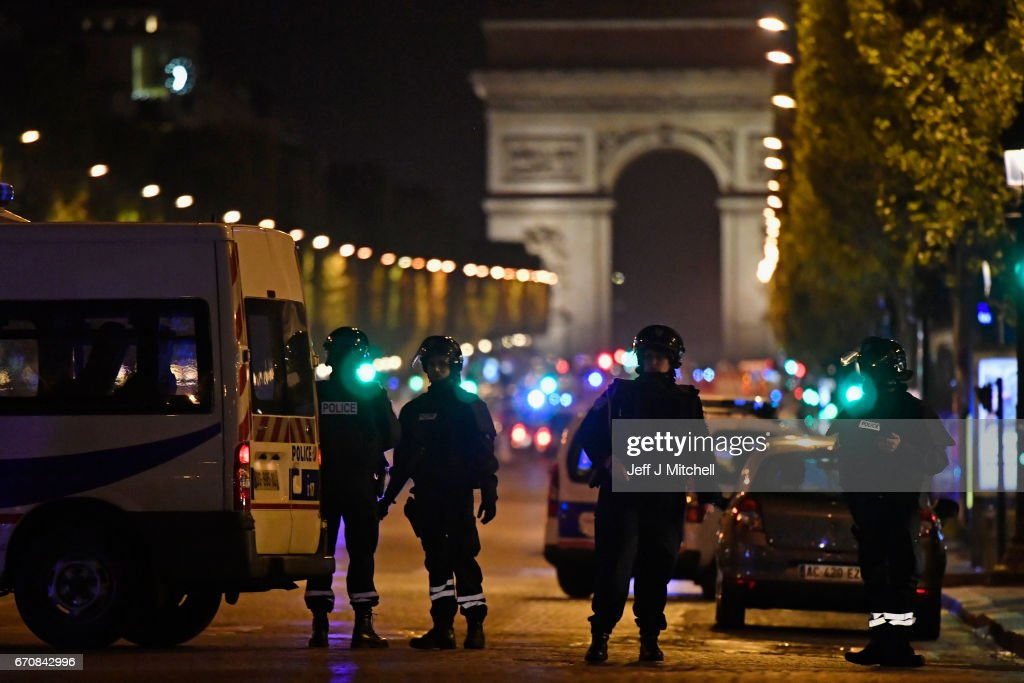 Police officers secure the area after a gunman opened fire on Champs Elysees on April 20, 2017 in Paris, France. One police officer has been killed, and a second injured by a gunman on The Champs Elysees. Security is heightened in Paris with the first round of France's presidential election on Sunday.