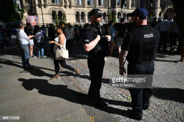 Police officers secure the area in Albert Square as the GreatCity Games gets underway in central Manchester northwest England on May 26 2017...