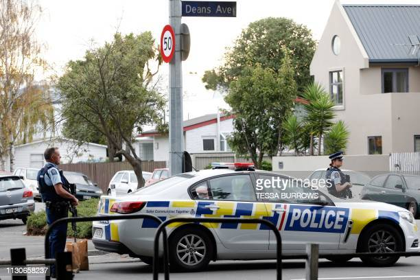 Police officers secure the area in front of the Masjid al Noor mosque after a shooting incident in Christchurch on March 15 2019 Attacks on two...