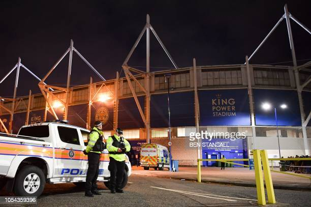Police officers secure the area outside Leicester City Football Club's King Power Stadium in Leicester eastern England on October 27 2018 after a...