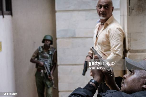 Police officers secure the building attached to the DusitD2 hotel in Nairobi Kenya on January 15 after a blast followed by a gun battle rocked the...