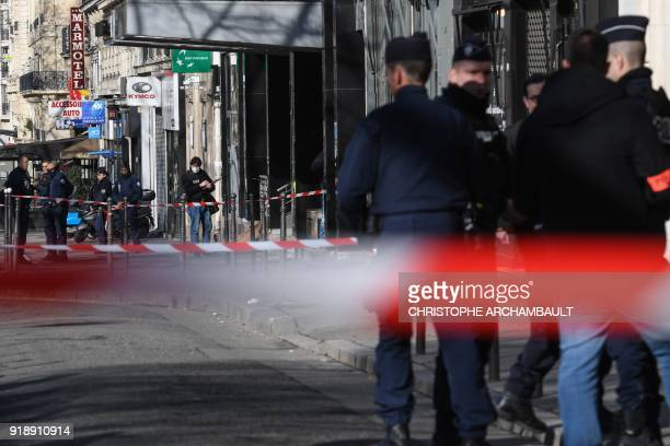 Police officers secure the cordonedoff area following a bank robbery attempt in a branch of the BNP Paribas bank at avenue de la GrandeArmee in...