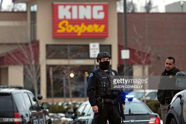 Police officers secure the perimeter of the King Soopers grocery store in Boulder, Colorado on March 22, 2021 after reports of an active shooter. -...