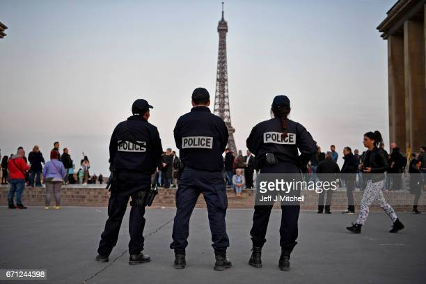 Police officers secure the Place du Trocadero in front of the Eiffel Tower the day after a gunman opened fire on police officers on the Champs...