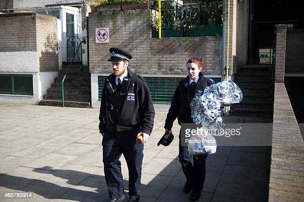Police officers seen leving the crime scene after gathering evidence from the flat where the murder took place A man was stabbed to death at 73...