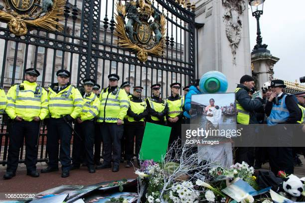 Police officers seen protecting the entrance to the Buckingham Palace Thousands of demonstrators from the new Extinction Rebellion climate change...