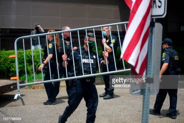 Police officers set up barricades outside of the Chinese consulate in Houston, Texas on July 24 after the US State Department ordered China to close...