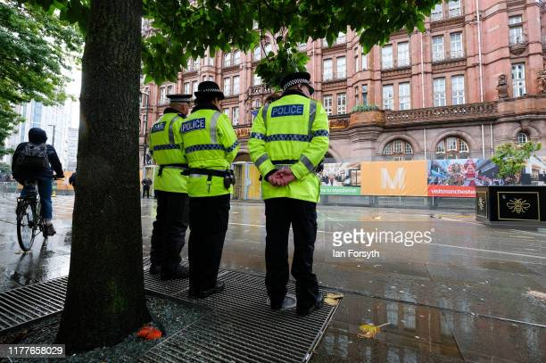 Police officers shelter from the rain as they provide security ahead of the Conservative Party Conference on September 28 2019 in Manchester England...