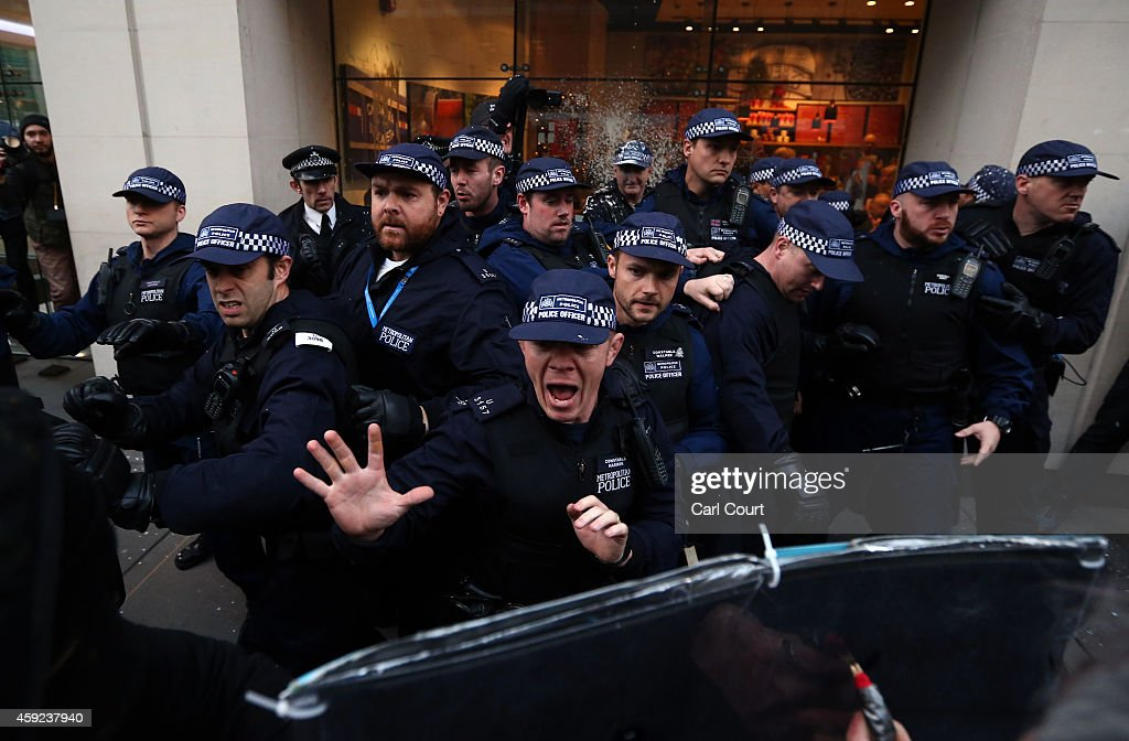 Police officers shout at protesters during a demonstration against fees and cuts in the education system on November 19, 2014 in London, England. A coalition of student groups have organised a day of nationwide protests in support of free education and to campaign against cuts. Photo by Carl Court/Getty Images)