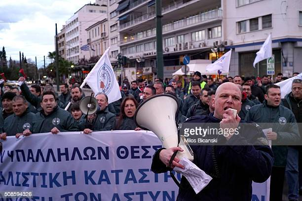 Police officers shouts slogans during their protest on February 5 2016 in Athens Greece Officers from the police coast guard and fire service are...