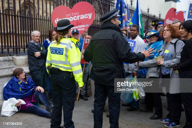 Police officers speak with remain campaigners outside the Houses of Parliament on 9th September 2019 in London United Kingdom Prime Minister Boris...