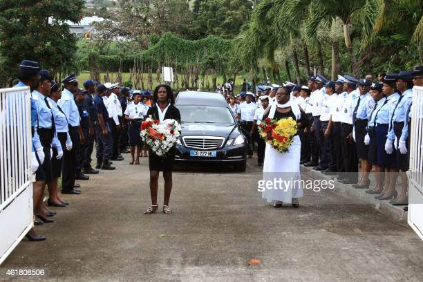 Police officers stand along the road as the hearse carrying the coffin of French municipal police officer from Martinique Clarissa JeanPhilippe who...