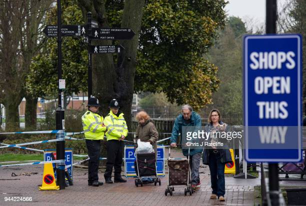Police officers stand at a cordon near the scene where former doubleagent Sergei Skripal and his daughter Yulia were discovered after being attacked...