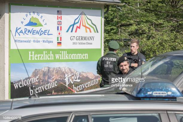 Police officers stand at a traffic checkpoint on a street heading to Schloss Elmau in Kruen, Germany, 03 June 2015. Government leaders from the G7...