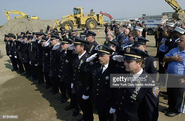 Police officers stand at attention during a solemn ceremony marking the formal end of the search for human remains in the World Trade Center debris...