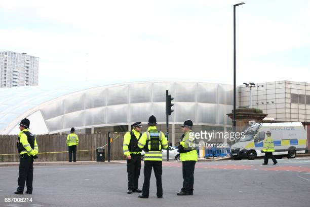 Police officers stand at the Miller Street and Corporation Street Crossroads in front of the Manchester Arena on May 23 2017 in Manchester England An...