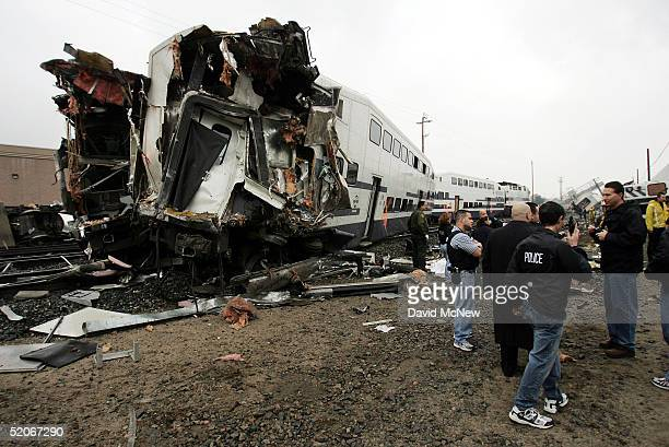 Police officers stand at the scene of a commuter train wreck January 26 2005 in Glendale California The wreck involving two commuter trains carrying...