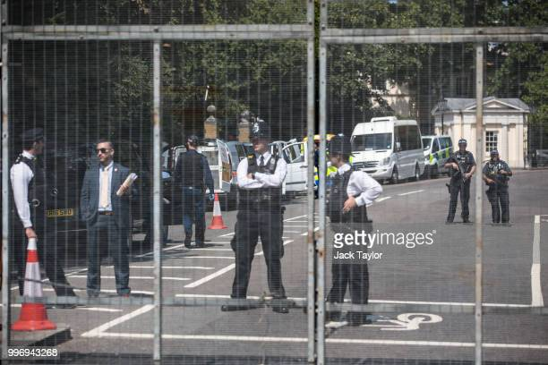 Police officers stand behind security fencing around Winfield House the London residence of US ambassador Woody Johnson ahead of President Donald...
