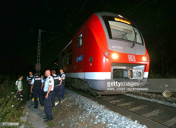 Police officers stand by a regional train in Wuerzburg southern Germany on July 18 2016 after a man attacked train passengers with an axe German...