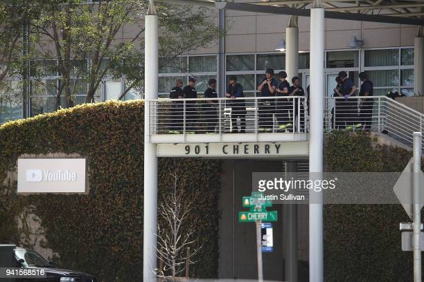Police officers stand by in front of the YouTube headquarters on April 3 2018 in San Bruno California Police are investigating an active shooter...