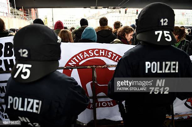Police officers stand by leftwing demonstrators who protest against a demonstration of supporters of KOEGIDA the Colognechapter of the xenophobic...