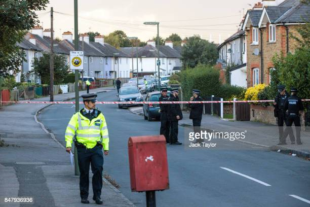 Police officers stand by on Cavendish Road during a raid on an address in connection with the terror attack at Parsons Green station on September 16...
