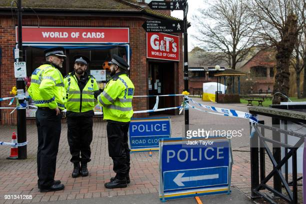 Police officers stand by the cordon as a forensics tent remains over a bench at the scene connected to the Sergei Skripal nerve agent attack as...