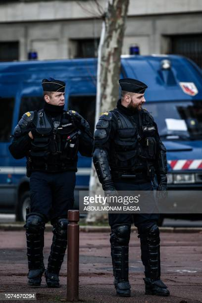 Police officers stand during a 'Yellow Vests' demonstration in front of the Chateau de Versailles in Versailles outside Paris on December 22 2018 The...