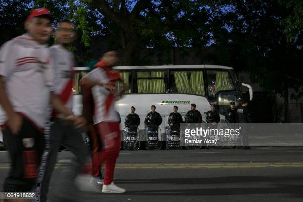 Police officers stand guard after the second leg final match of Copa CONMEBOL Libertadores 2018 between River Plate and Boca Juniors on November 24...