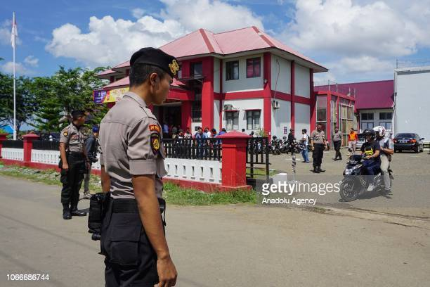 Police officers stand guard around the Class IIA Penitentiary in Lambaro Aceh Besar Aceh Indonesia on November 30 2018 At least 113 inmates escaped...