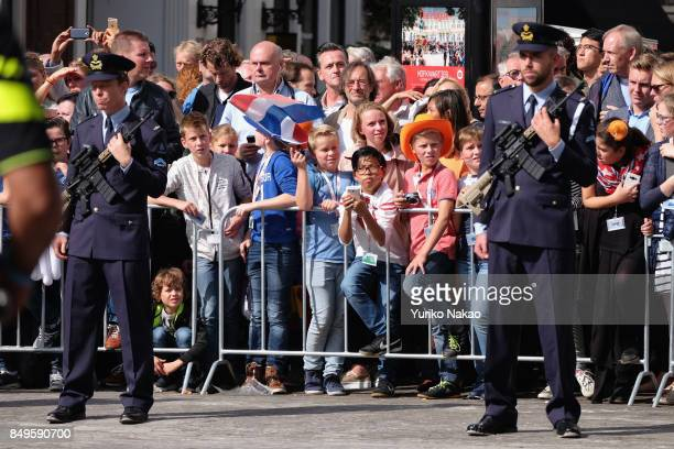 THE Police officers stand guard as people wait for the start of the proceedings of the King and Queen of The Netherlands for the Prinsjesdag on...