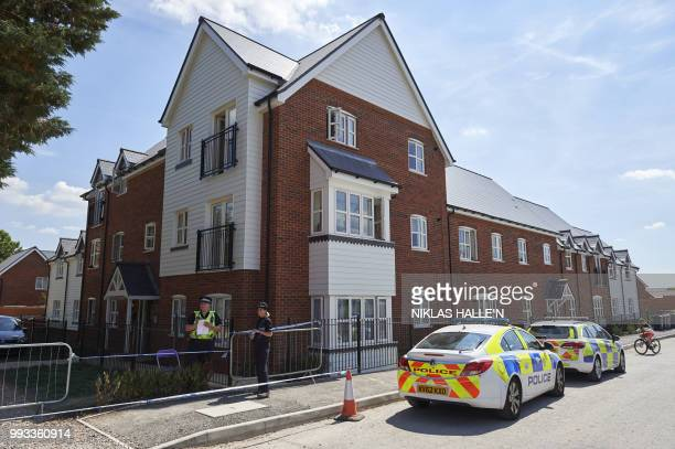 Police officers stand guard at a residential house in Amesbury southern England on July 7 2018 The exposure of an apparently random British couple to...