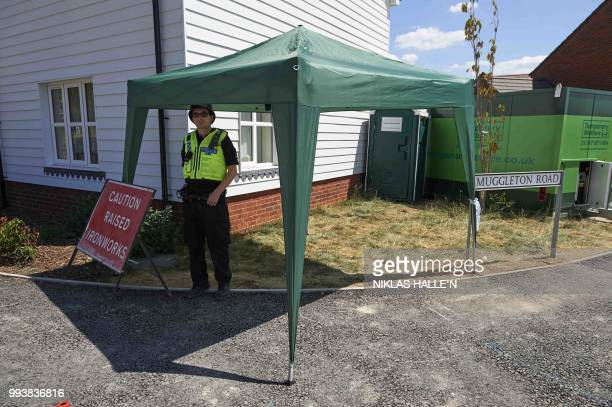 Police officers stand guard at a residential house in Amesbury southern England on July 8 2018 The exposure of an apparently random British couple to...
