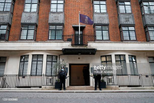 Police officers stand guard at the entrance of the King Edward VII's Hospital, in central London on March 5 where Britain's Prince Philip, Duke of...
