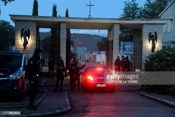 Police officers stand guard at the entrance of the Mingorrubio cemetery at El Pardo north of Madrid on October 24 as part of the exhumation of...