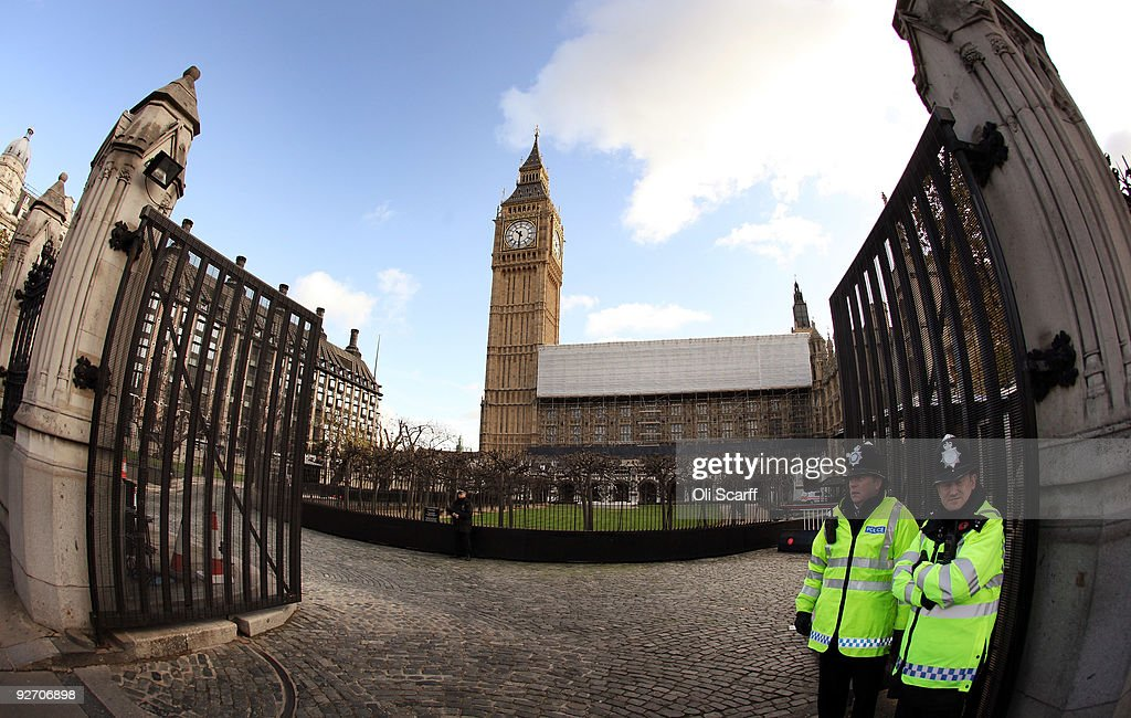 Police officers stand guard at the gates of the Houses of Parliament on November 3, 2009 in London, England. A review into MP's expenses published today by Sir Christopher Kelly has recommended that MP's mortgage claims should be replaced by rental claims and the employment of relatives should be phased out within five years.