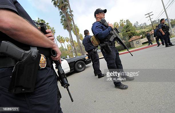 Police officers stand guard at the roadblock at the entrance to the Los Angeles Police Academy in Los Angeles California February 7 2012 California...