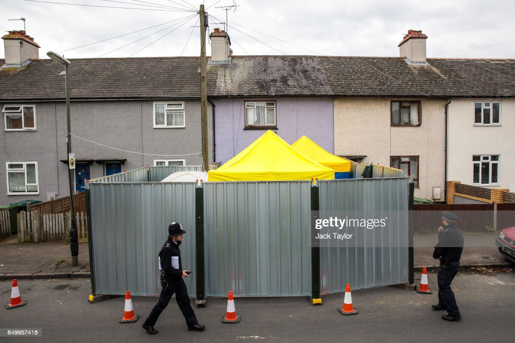 Police officers stand guard by a barrier around a property being searched in connection with the attack on Parsons Green station on September 13, 2017 in Sunbury, England. Two further arrests have been made in Newport, Wales by police investigating the September 15th Parsons Green terror attack, in which 30 people were injured.