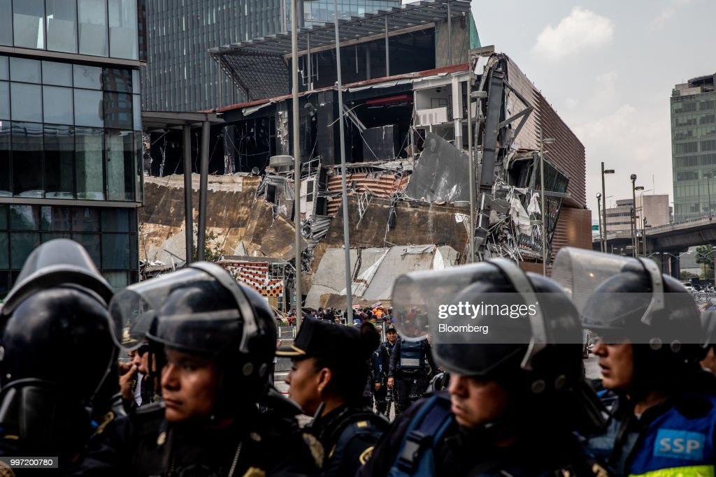 Police officers stand guard in front of the collapsed section of the Artz Pedregal shopping mall in Mexico City, Mexico, on Thursday, July 12, 2018. A section of the high-end fashionmallinaugurated a mere three months ago collapsed Thursday afternoon in Mexico City. Photographer: Alejandro Cegarra/Bloomberg via Getty Images