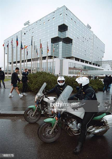 Police officers stand guard in front of the Hilton hotel November 19 2002 in Prague Czech Republic U S President George Bush will be staying at the...