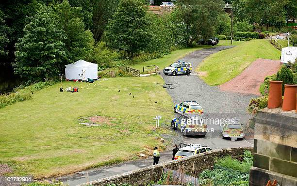 Police officers stand guard in Rothbury on July 10, 2010 as Raoul Thomas Moat, suspected of shooting three people in northeast England killed himself...