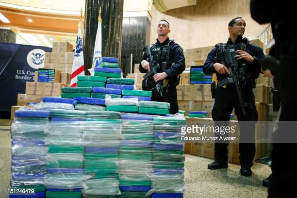 Police officers stand guard near cocaine seized from a cargo ship at a Philadelphia port, during a news conference at the U.S. Custom House on June...