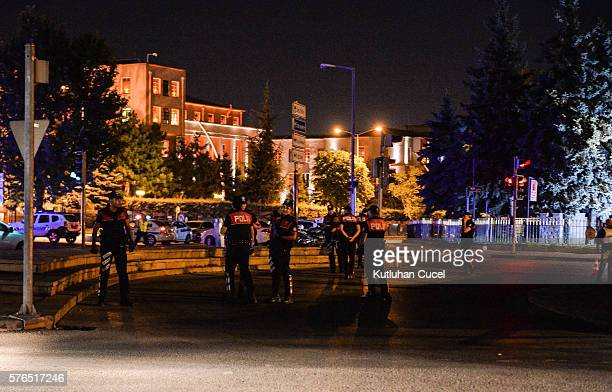 Police officers stand guard near the Turkish military headquarters on July 15 2016 in Ankara Turkey Istanbul's bridges across the Bosphorus the...