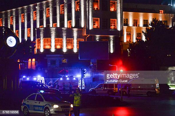 Police officers stand guard near the Turkish military headquarters July 15 2016 in Ankara Turkey Istanbul's bridges across the Bosphorus the strait...