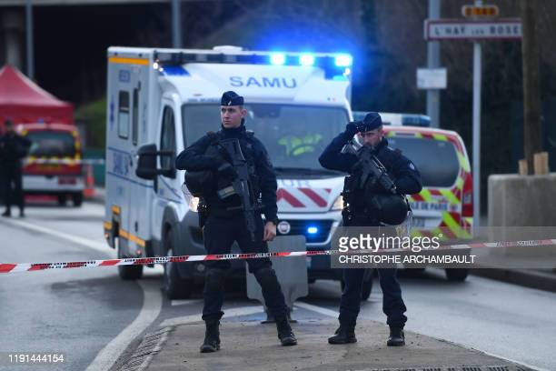 Police officers stand guard on January 3 2020 in L'HaylesRoses on the site where police shot dead a knifewielding man who killed one person and...