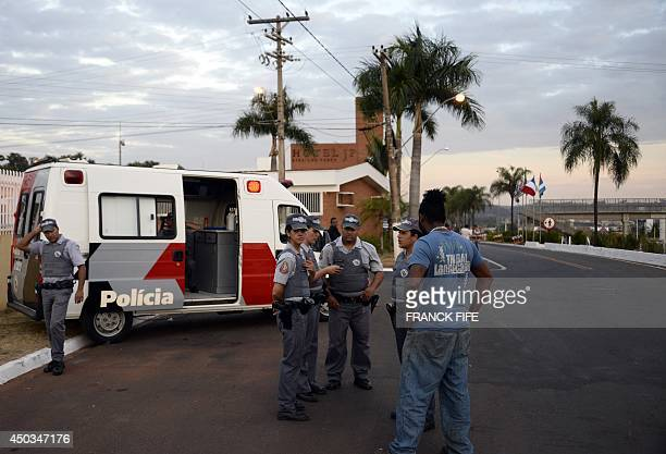 Police officers stand guard on June 9, 2014 in Ribeirao Preto in front of the entrance of the JP Hotel which will host the French national football...
