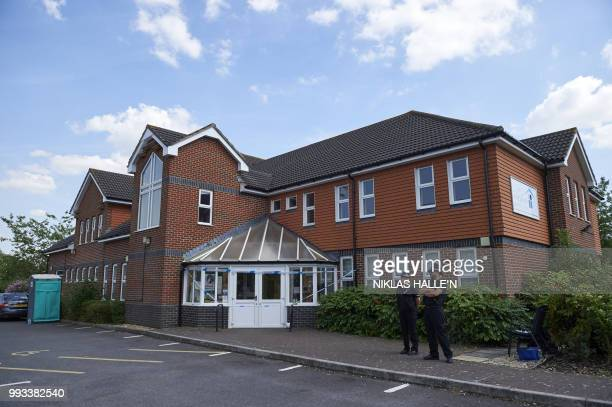 Police officers stand guard outside Amesbury Baptist Centre in Amesbury southern England on July 7 2018 The exposure of an apparently random British...