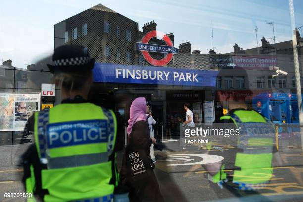 Police officers stand guard outside FInsbury Park underground station near Finsbury Mosque on June 20 2017 in London England A man was held on...