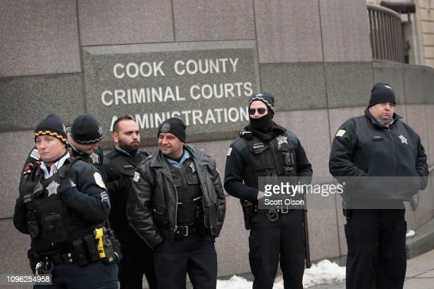 Police officers stand guard outside of the sentencing hearing for former Chicago police officer Jason Van Dyke at the Leighton Criminal Courthouse on...