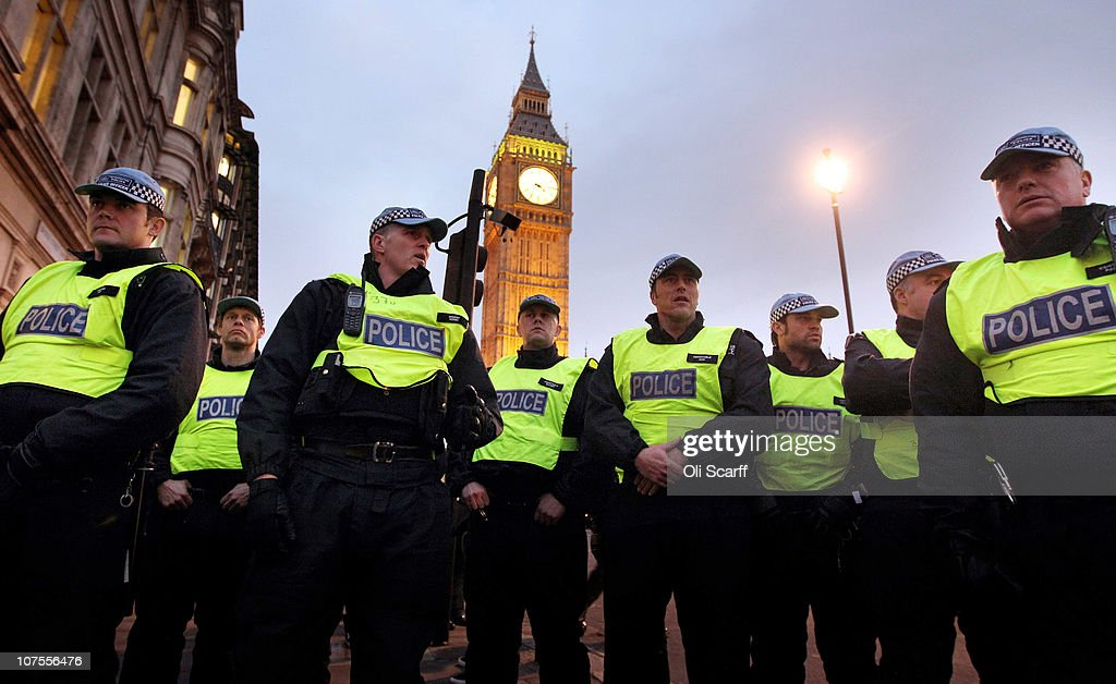 Police officers stand guard outside Parliament during student protests on December 13, 2010 in London, England. Protesters are calling on the government not to scrap the Education Maintenance Allowance (EMA). The EMA was designed to help poorer pupils to stay in education.